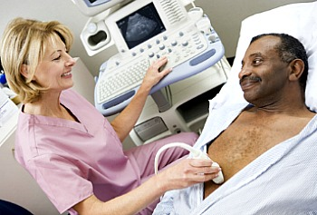 Man with AAA lying in bed under the care of a doctor during the screening process